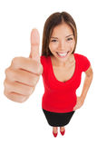 Thumbs up woman standing in full body length. Thumbs up woman. Fun high angle full body portrait of a vivacious laughing woman giving a thumbs up gesture of Stock Images