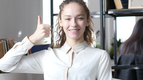 Thumbs Up By Woman, Indoor Office Stock Photo
