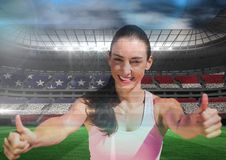 Thumbs up woman in a stadium Royalty Free Stock Image