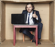 Thumbs up for work in big corporation Royalty Free Stock Photography