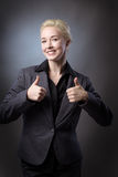 Thumbs up at work Stock Photo