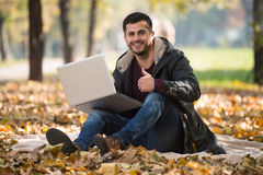 Thumbs Up For Working Outdoors Autumn Season. Handsome Man Working On Laptop In Park During Autumn Season Stock Images