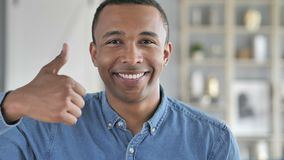 Thumbs Up by Young African Man Looking at Camera stock video