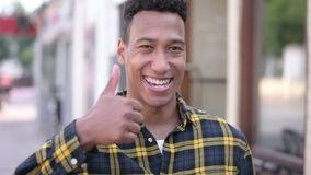 Thumbs Up by Young African Man, Outdoor stock video footage