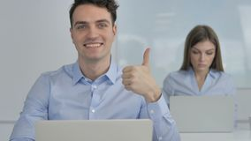 Thumbs Up by Young Businessman in Office stock video footage