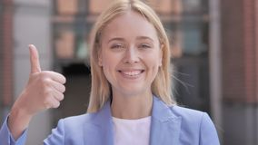 Thumbs Up by Young Businesswoman, Outdoor stock footage