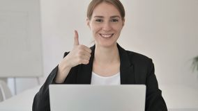 Thumbs Up by Young Businesswoman at Work stock video