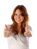 Thumbs up. Young female (isolated, focus on hands). Thumbs up. Pretty young woman on white background (focus on hands Royalty Free Stock Image