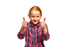 Thumbs up. Young girl with thumbs up stock photo