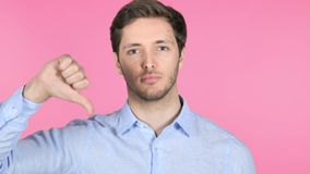 Thumbs Up by Young Man on Pink Background stock video footage