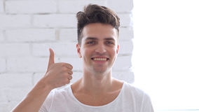 Thumbs Up by Young Man, Positive. High quality Stock Image