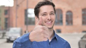 Thumbs Up by Young Man Standing Outdoor. 4k high quality, 4k high quality stock video footage