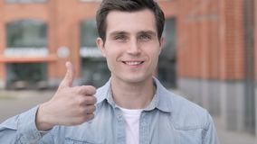Thumbs Up by Young Man Standing Outdoor. 4k high quality, 4k high quality stock footage