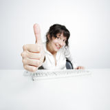 Thumbs up! Young woman happily says OK Royalty Free Stock Photo