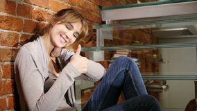 Thumbs Up by Young Woman Sitting Relax on Stairs. 4k , high quality stock video