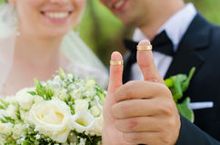 Thumbs with wedding rings Stock Photography