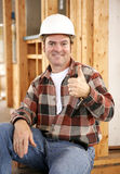 Thumbsup on Construction Site. A handsome construction worker giving a thumbsup sign. Authentic construction worker on actual construction site royalty free stock image