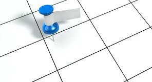 Thumbtack With Blank Label On Generic Calendar. A blue thumbtack with a blank white tape tag attached to it on a generic calendar grid background Stock Photos