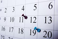 Calendar appointment date. Thumbtack in calendar concept for busy, appointment and meeting reminder Royalty Free Stock Images