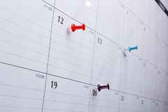 Calendar appointment date. Thumbtack in calendar concept for busy, appointment and meeting reminder Stock Photos
