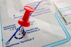 Thumbtack on Heathrow station in london underground map Royalty Free Stock Image