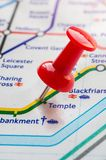 Thumbtack on Temple station in london underground map Stock Photography