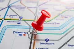 Thumbtack on Waterloo station in london underground map Stock Photography