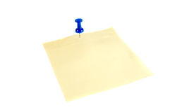 Thumbtack on yellow note Stock Image