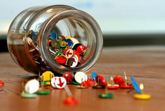 Thumbtacks. In a glass on a table Stock Image