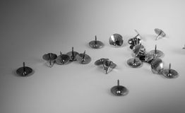 Thumbtacks. Black and white image of scattered thumbtacks Royalty Free Stock Photos