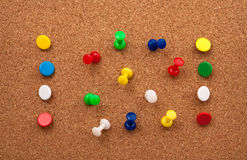 Thumbtacks in cork board Royalty Free Stock Photography