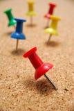 Thumbtacks on cork board Stock Images