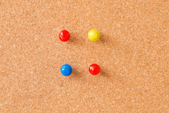 Thumbtacks on cork board Stock Photography