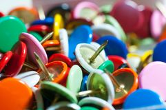 Thumbtacks in different colors close up stock photography