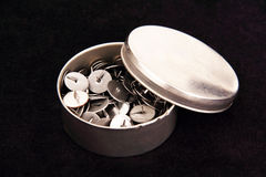 Thumbtacks in a metal box. Royalty Free Stock Images