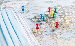 Free Thumbtacks Pinned And Face Mask On A Map Of Europe Stock Photos - 191504513