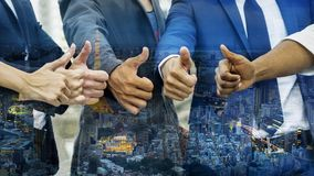 Thump up hand from the group of business people with the overlay Stock Photos