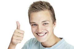 Thumps up. Photo of a young man giving a  thumbs up Royalty Free Stock Photo