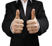 Thumps up. Man in a suit putting his thumbs up Stock Photo