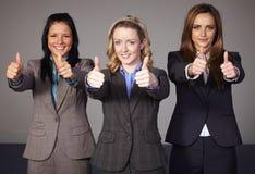 thums för affärskvinnagestshow tre upp royaltyfria foton