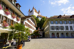Thun Castle towering over the Town Hall Square Stock Photos