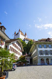 Thun Castle towering over the Town Hall Square Royalty Free Stock Images