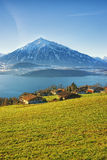 Thun lake village houses view in winter morning Royalty Free Stock Photos