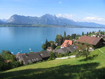 Thun lakeview panorama. View of the Thun lake with cottages Royalty Free Stock Images