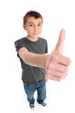 Thunbs da mão grande do menino acima Fotografia de Stock Royalty Free