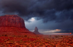 Thunder. The famous buttes of Monument Valley, Utah drenched by an early morning thunder shower Stock Photo