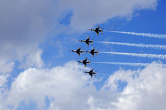 Thunder bird US Airforce team. Thunderbirds perform team formations during flyover at Daytona Beach, Fl royalty free stock photos