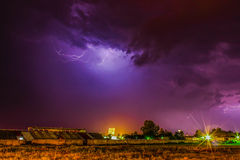Thunder Cloud over the village and lightning coming out of it Stock Image