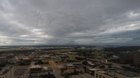 Thunder clouds move over North Kansas City  Missouri. Storm clouds move over North Kansas City and the Missouri River time lapse stock footage