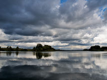 Thunder clouds over lake Stock Image